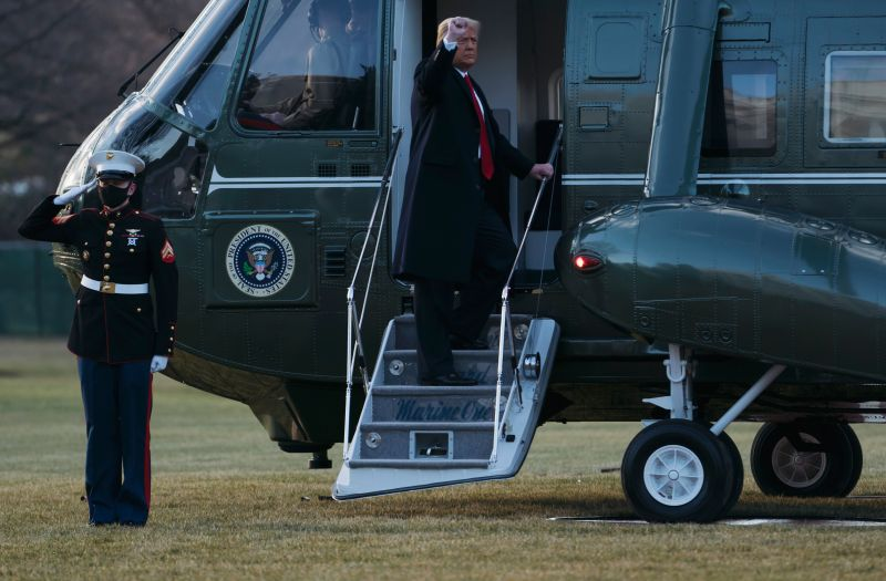 President Donald Trump and first lady Melania Trump board Marine One as they depart the White House in Washington on Jan. 20.