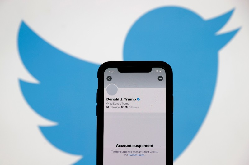 An iPhone screen displays U.S. President Donald Trump's suspended Twitter account in San Anselmo,  California, on Jan. 8.