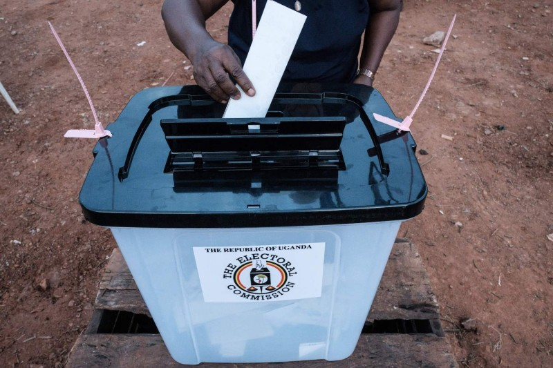 A voter casts a ballot at a polling station in Kampala, Uganda, on January 14, 2021.