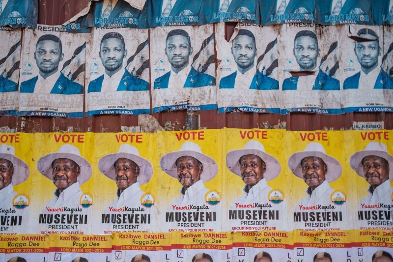 Posters for incumbent President Yoweri Museveni and Bobi Wine, the pop star-turned-opposition leader, are seen along a street in Kampala, Uganda, on Jan. 6.