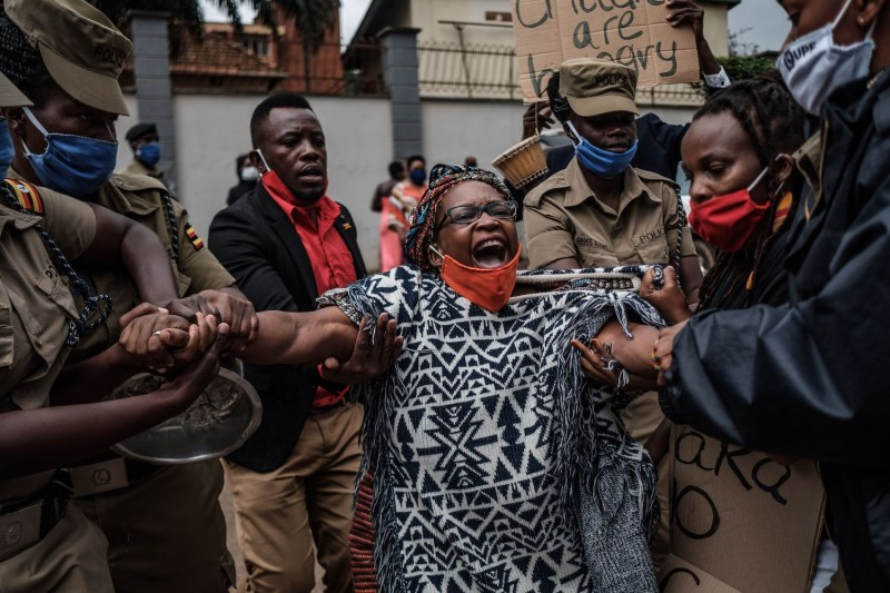 Activist Stella Nyanzi is arrested by police officers at a protest for more government food distribution amid the coronavirus lockdown in Kampala, Uganda, on May 18, 2020.