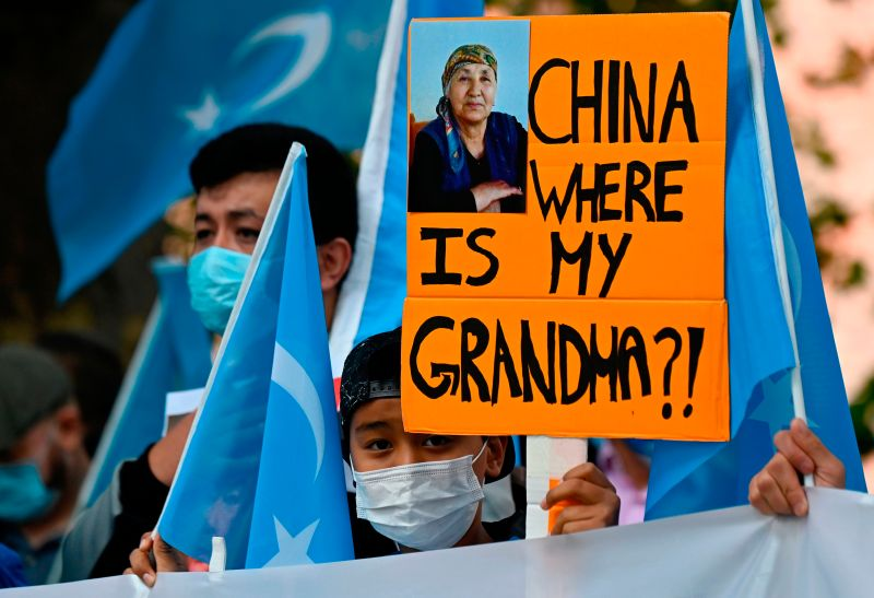 A young Uighur activist holds up a poster during a demonstration outside the Foreign Office in Berlin before talks between the Chinese and German foreign ministers on Sept. 1.