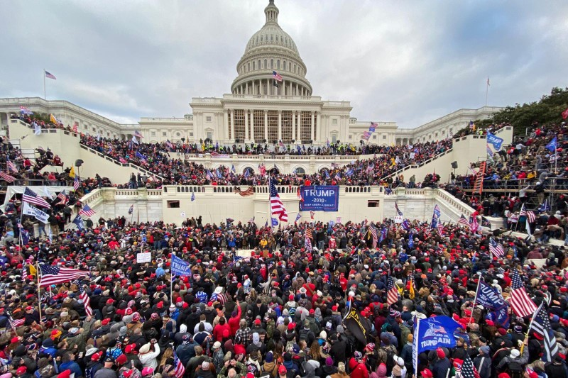 Pro-Trump supporters gather outside the U.S. Capitol building in Washington as a mob breaches the building on Jan. 6.
