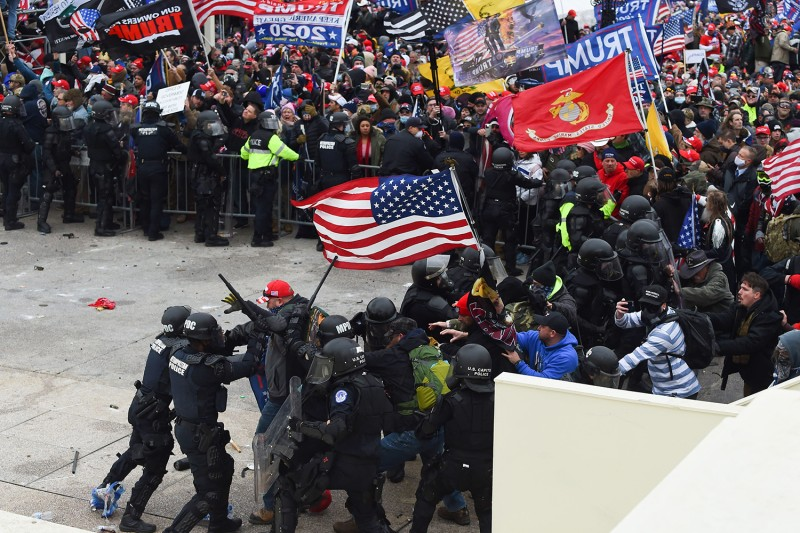 Trump supporters clash with police and security forces as they storm the U.S. Capitol in Washington on Jan. 6.