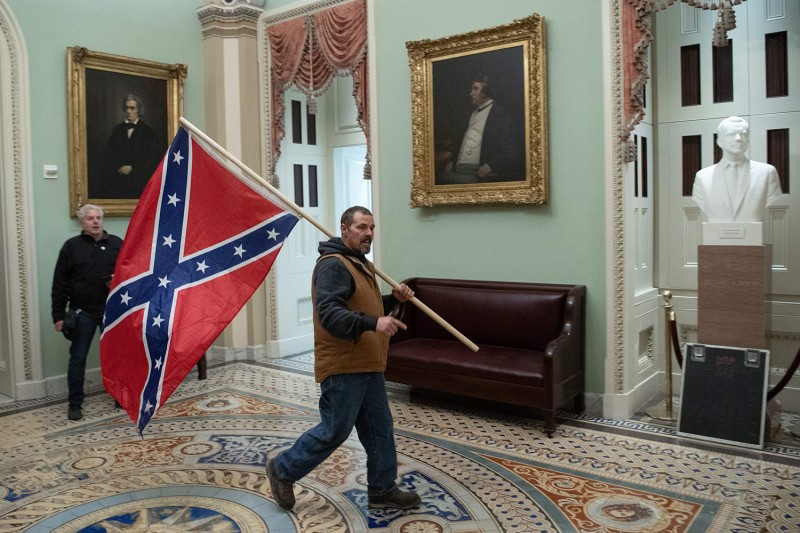 A supporter of U.S. President Donald Trump carries a Confederate flag through the U.S. Capitol rotunda in Washington on Jan 6.