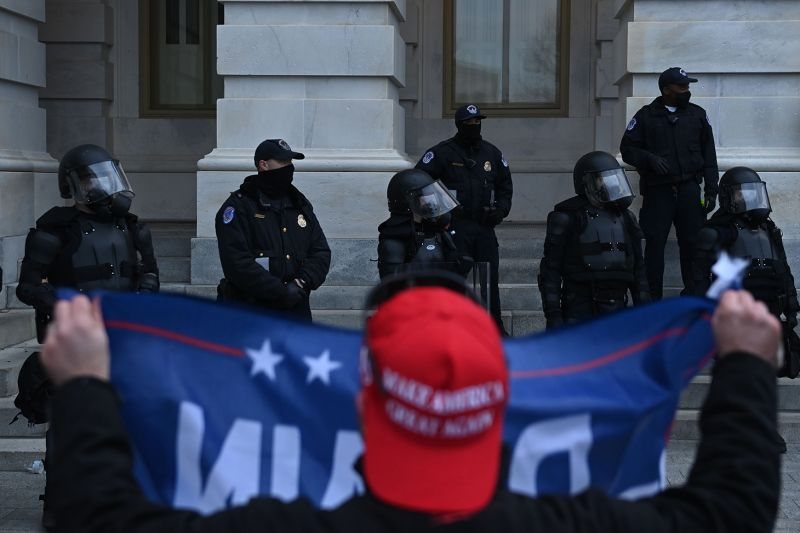 Trump supporters confront police and security forces at the U.S. Capitol in Washington on Jan. 6.