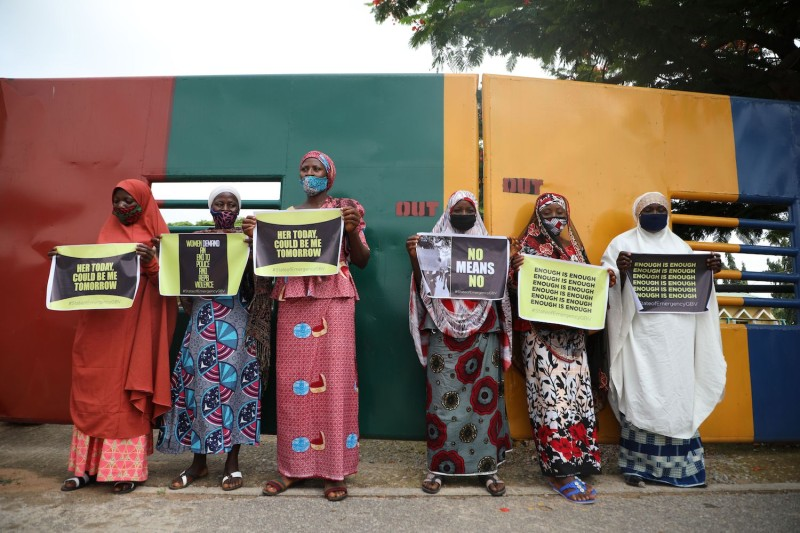 Protesters hold placards outside the Nigerian Police headquarters in Abuja during a demonstration to raise awareness about sexual violence on June 5, 2020.