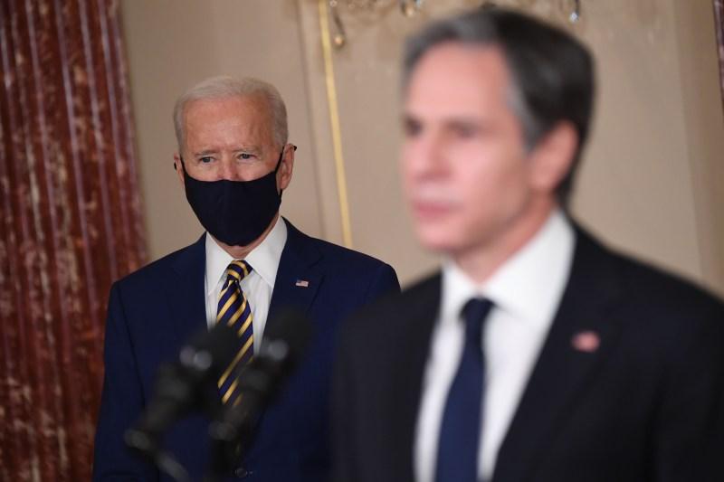 U.S. President Joe Biden and Secretary of State Antony Blinken speak at the State Department.