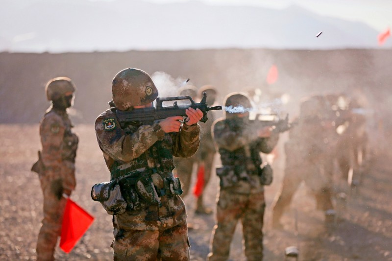 People's Liberation Army soldiers take part in military training at the Pamir Mountains in Kashgar, China, on Jan. 2.