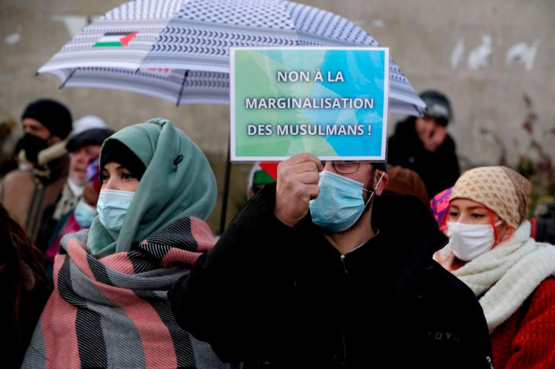 """Protesters demonstrate against the so-called """"anti-separatism"""" bill in Paris on Feb. 14."""