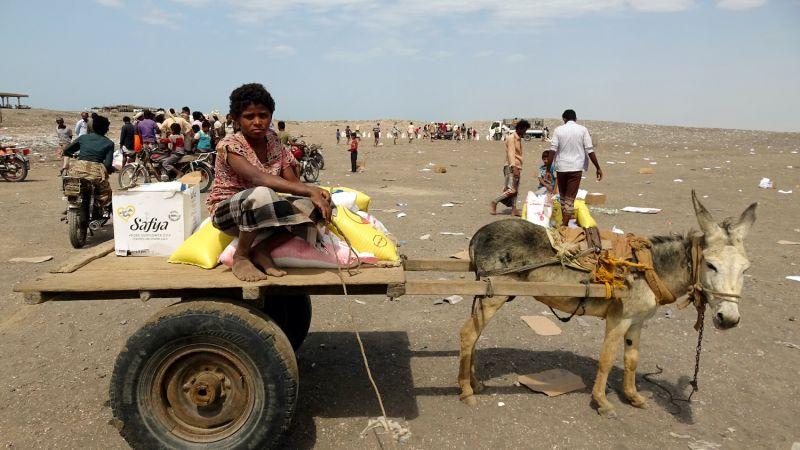 Displaced Yemenis receive food aid donated by a British organization in Yemen's western  province of Hodeida on Feb. 9.