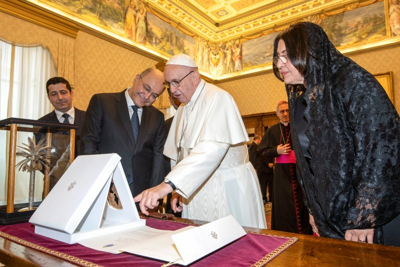 Pope Francis exchanges gifts with Iraq's President Barham Salih and his wife, Sarbagh Salih, during a private audience at the Vatican on Nov. 24, 2018.