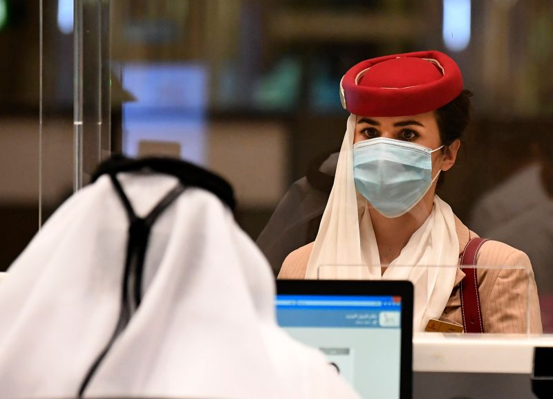 A stewardess of an Emirates airlines flight from London arrives at Dubai International Airport on May 8, 2020 amid the COVID-19 pandemic.