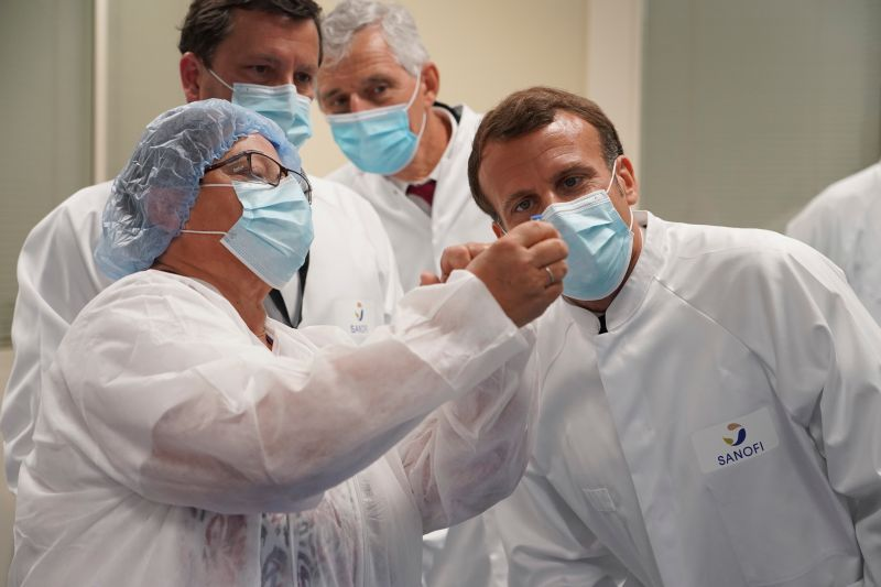 French President Emmanuel Macron visits an industrial development laboratory at French drugmaker's vaccine unit Sanofi Pasteur plant in Marcy-l'Etoile, near Lyon, central France, on June 16, 2020.