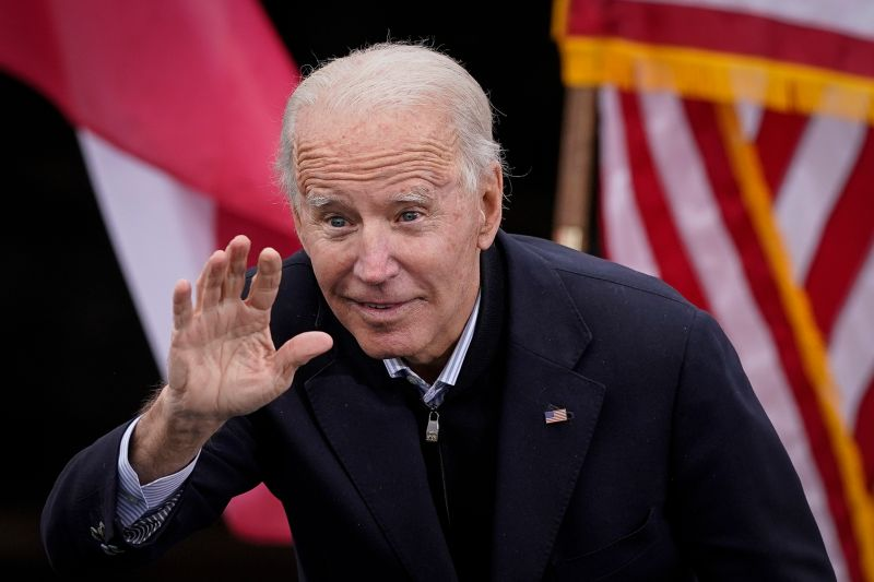Joe Biden gestures to the crowd as he delivers remarks during a drive-in rally for U.S. Senate candidates Jon Ossoff and Rev. Raphael Warnock at Pullman Yard on Dec. 15, 2020 in Atlanta, Georgia.