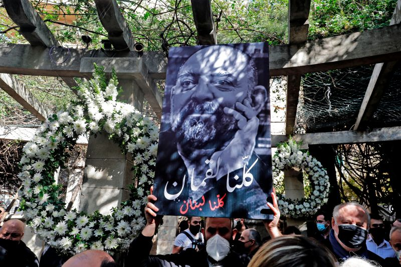 Friends and family members of slain prominent Lebanese activist and intellectual Lokman Slim, attend a memorial ceremony in the garden of the family residence in the capital Beirut's southern suburbs, a week after he was found dead in his car, on Feb 11, 2021.