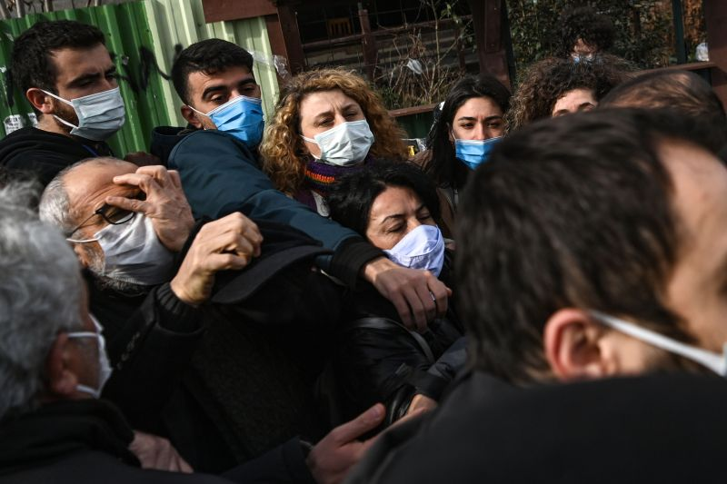 Turkish plain clothed police officers hold a group of protesters during a demonstration in support of Bogazici University students in front of Istanbul's courthouse, on Feb. 11.