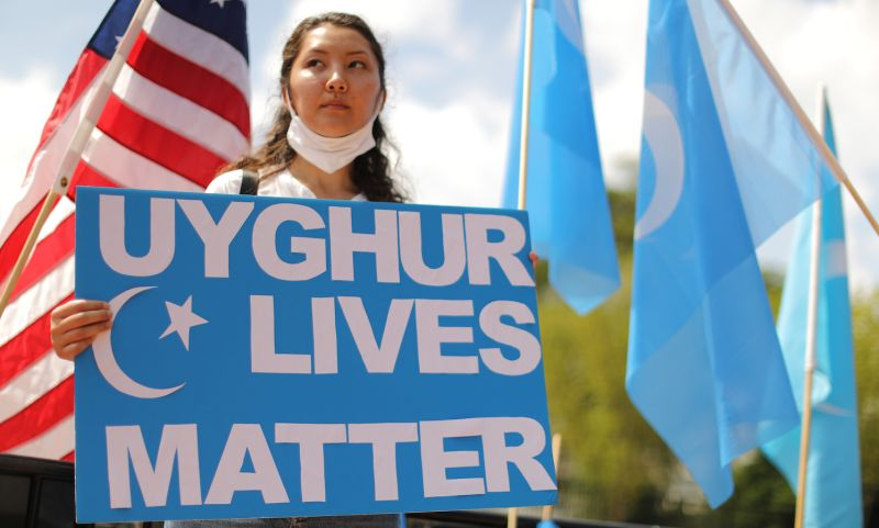 Pro-Uighur protesters demonstrate outside the White House in Washington, on Aug. 14, 2020.