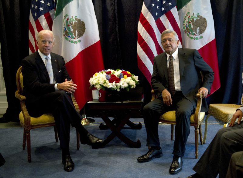 Joe Biden shakes hands with Andres Manuel Lopez Obrador during a meeting on March 5, 2012 in Mexico City.