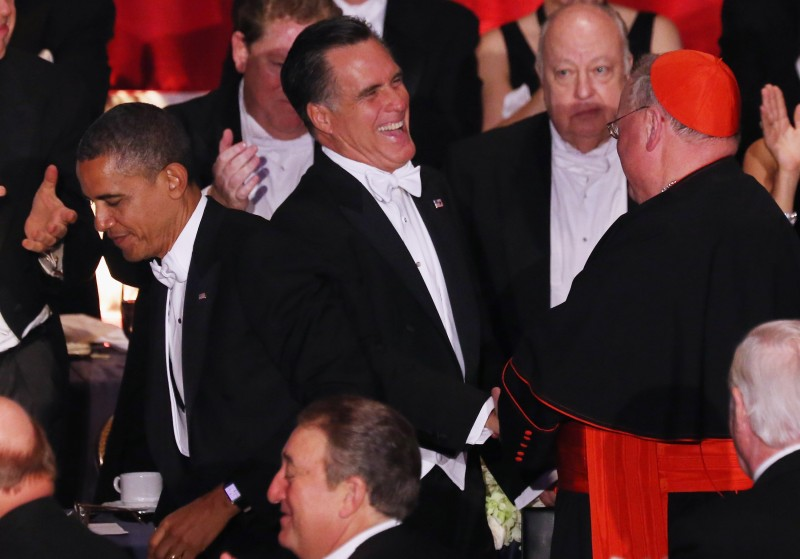 Roman Catholic Cardinal and Archbishop of New York Timothy Dolan and Mitt Romney attend the 67th Annual Alfred E. Smith Memorial Foundation Dinner at the Waldorf-Astoria Hotel on Oct. 18, 2012 in New York City.