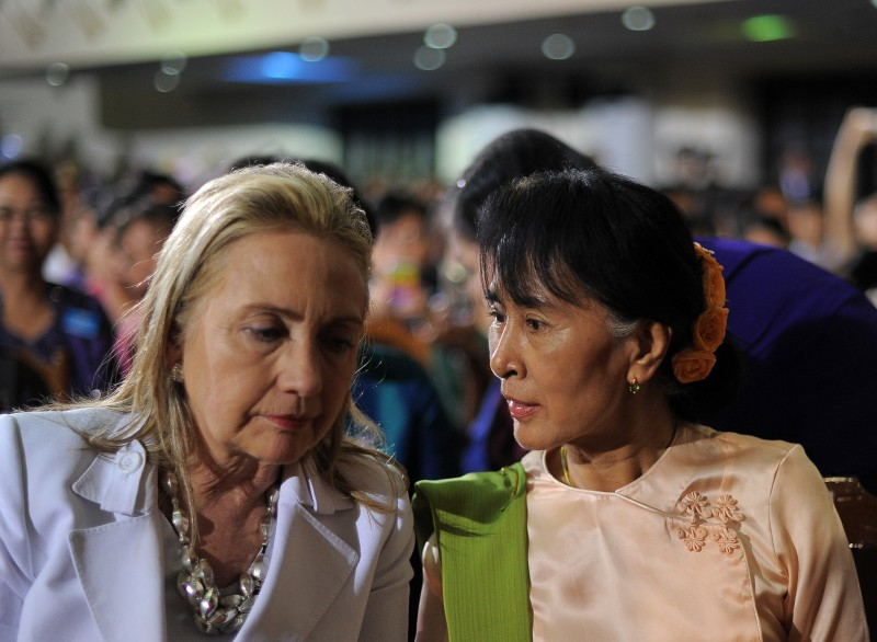 U.S. Secretary of State Hillary Clinton chats with Myanmar opposition leader Aung San Suu Kyi