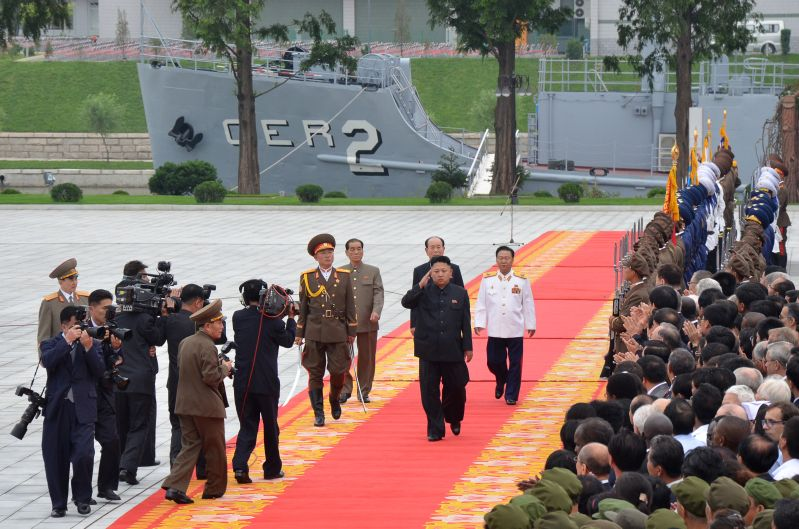 North Korean leader Kim Jong Un walks in front of the USS Pueblo