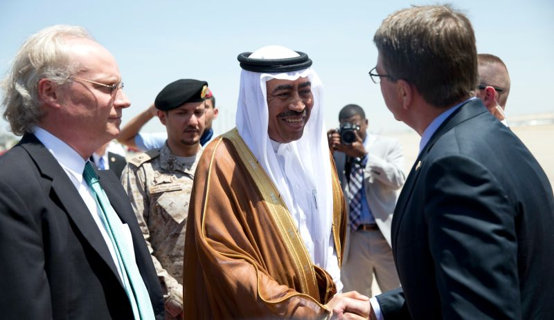 Former U.S. Defense Secretary Ash Carter is greeted by then-Saudi Arabian Assistant Minister of Defense Mohammad Al-Ayesh, center, and then-U.S. Embassy Deputy Chief of Mission Tim Lenderking, left, as he arrives on a E4-B military aircraft at King Abdulaziz International Airport on July 22, 2015 in Jeddah, Saudi Arabia.