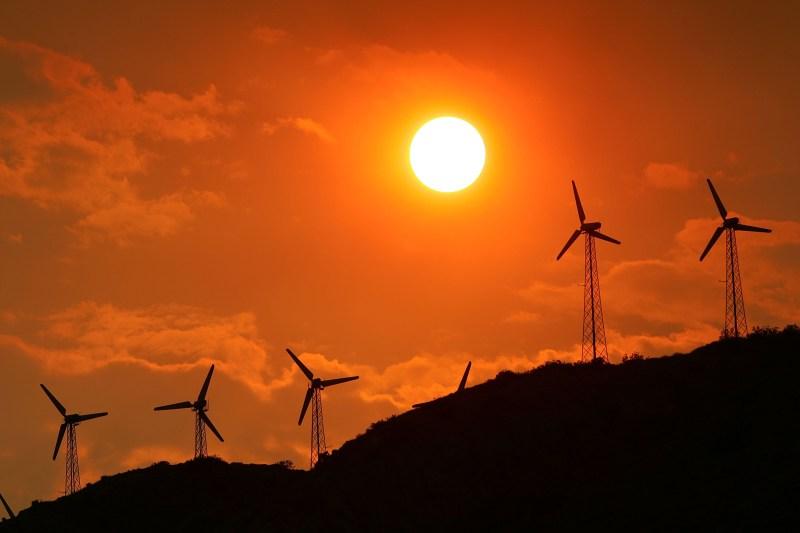 Wind power generators are enveloped in a smoky sky near the Millard fire near Cabazon, California, on July 15, 2006.