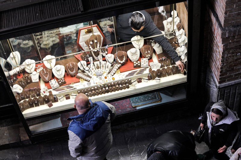 A man browses jewelry through the window of a shop at the Grand Bazaar in Tehran on Feb. 12, 2020.