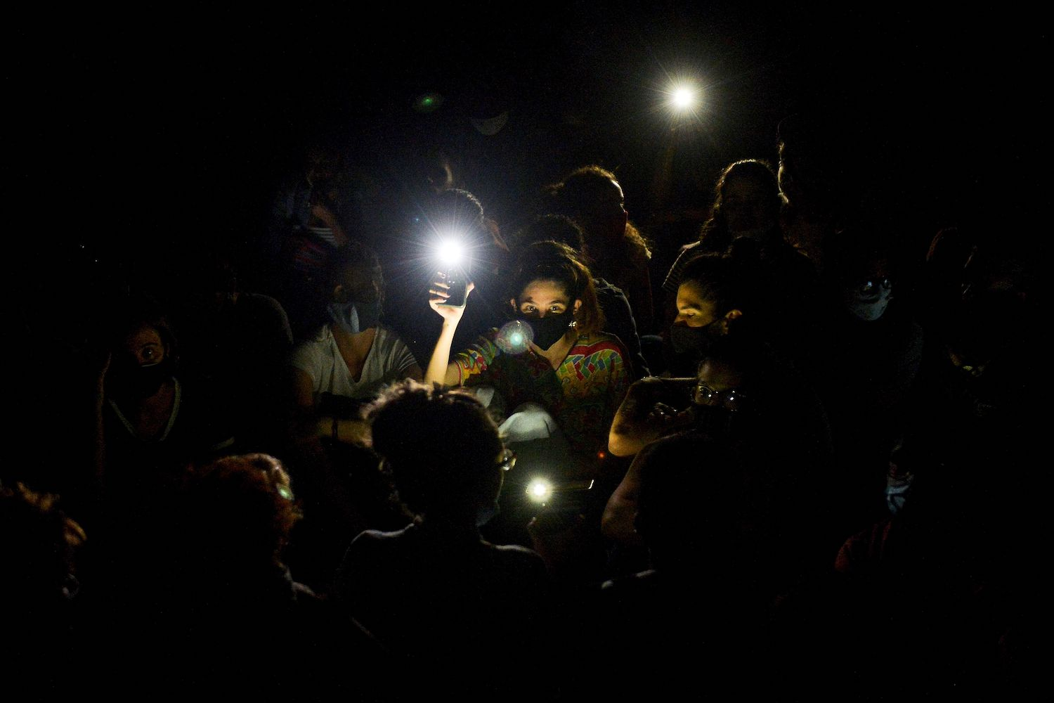 A group of young intellectuals and artists hold up lights on their mobile phones during a demonstration at the doors of the Ministry of Culture in Havana, on Nov. 28, 2020.