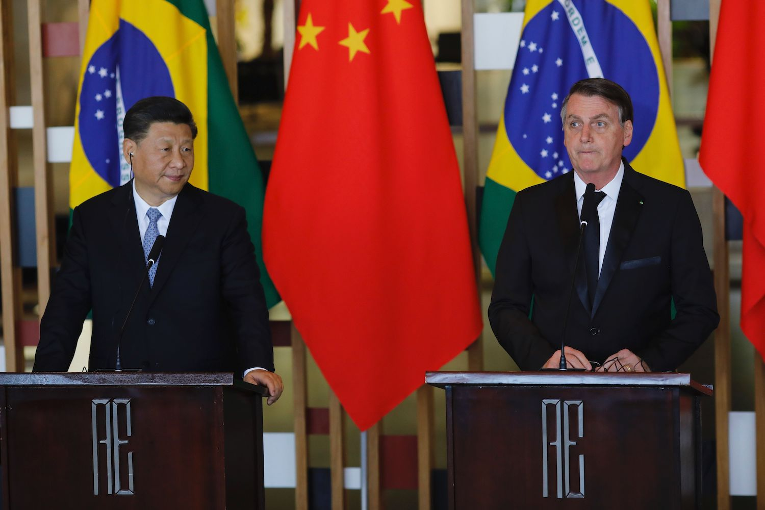 Chinese President Xi Jinping and Brazilian President Jair Bolsonaro attend a press statement after a bilateral meeting in Brasilia, Brazil, on Nov. 13, 2019.