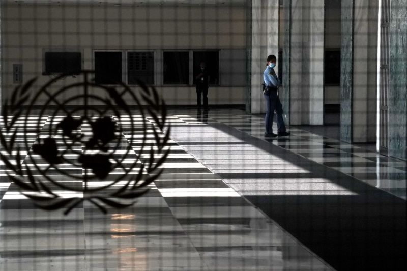 A U.N. police officer stands at an empty entrance at the United Nations Sept. 22, 2020.