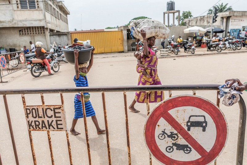 People carry merchandise at the Benin-Nigeria border city of Krake on Dec. 17, 2020.