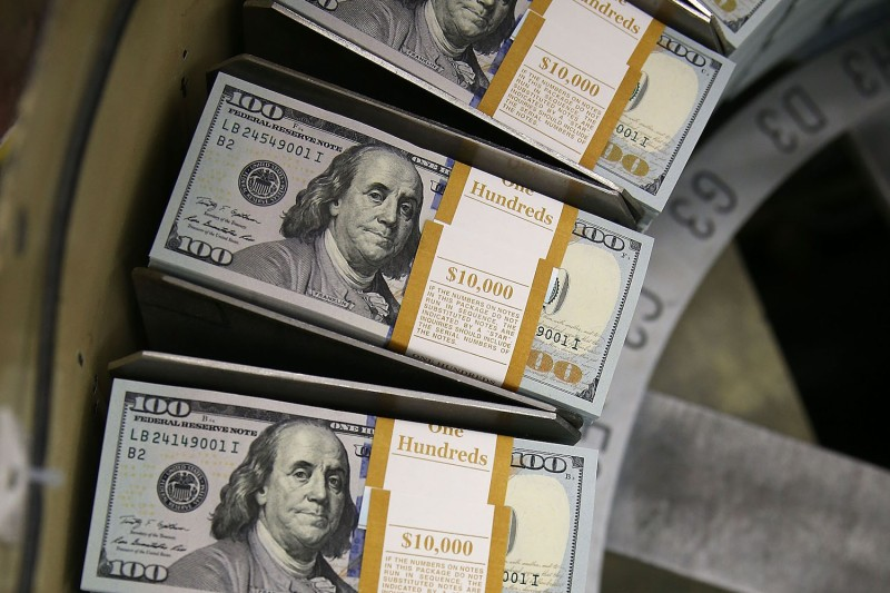 $100 bills are printed at the U.S. Bureau of Engraving and Printing in Washington on May 20, 2013.
