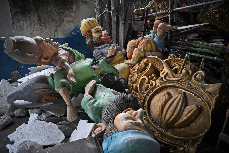 Broken statues from carnival floats are seen nea the Sambadrome venue in Rio de Janeiro, Brazil on Feb. 13.