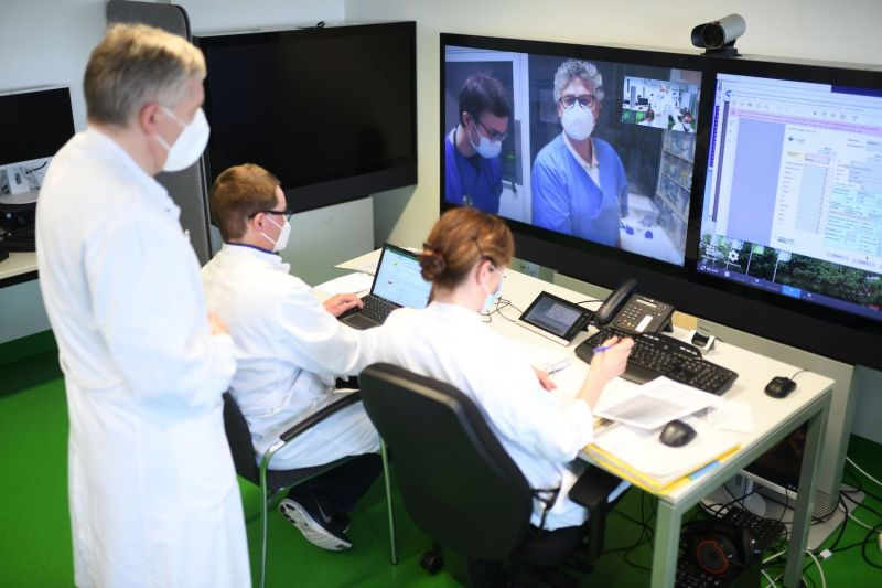 Doctors use telemedicine for the treatment of COVID-19 patients at Uniklinikum Aachen, the university hospital in Aachen, Germany, on Jan. 20.