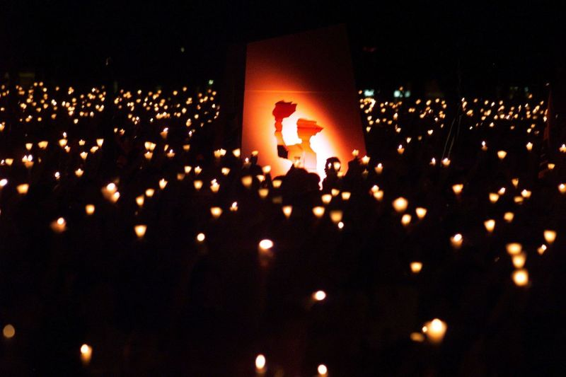 A cutout of the Goddess of Democracy stands out in a sea of light during a vigil to remember the Tiananmen Square movement on its 10th anniversary in Hong Kong, on June 4, 1999.