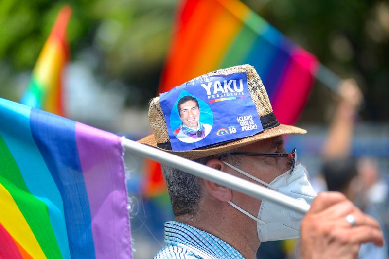 A supporter of Ecuadorian Presidential candidate Yaku Perez holds a flag outside the Electoral Delegation building in Guayaquil, Ecuador on Feb. 10.