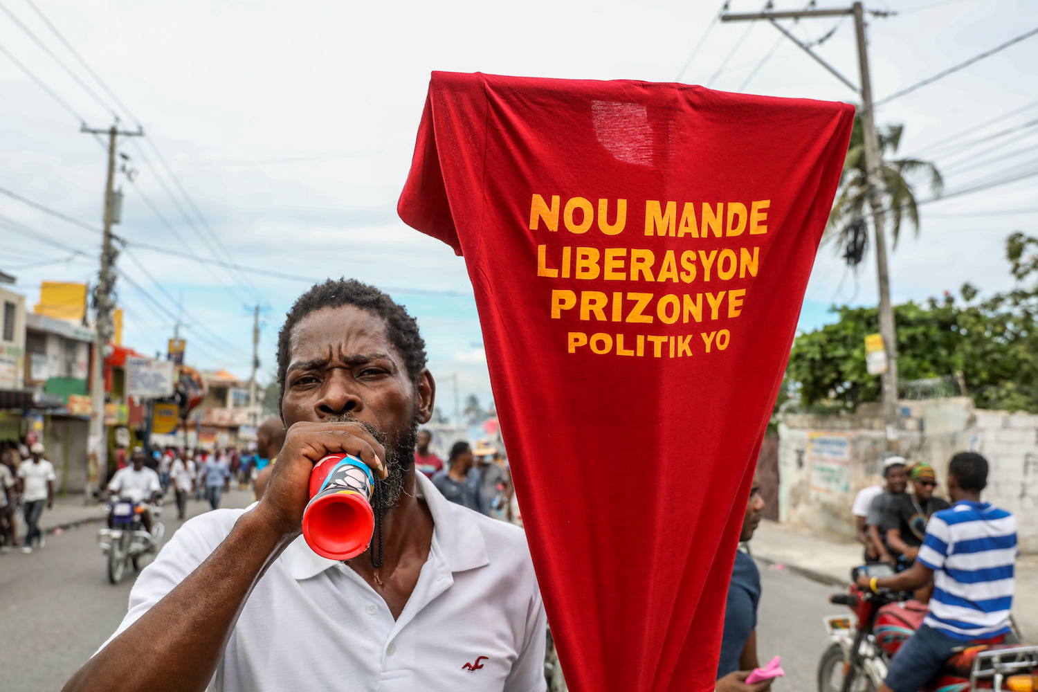 Opposition protesters call for the departure of President Jovenel Moise as they march through the streets of Port-au-Prince on Nov. 18, 2020.