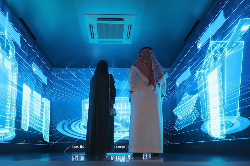 Saudi nationals attend the Gitex 2018 exhibition at the Dubai World Trade Center in Dubai on Oct. 16, 2018.