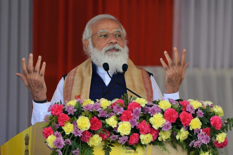 Indian Prime Minister Narendra Modi gestures as he addresses a public meeting at Jerenga Pathar in Assam, India, on Jan. 23.