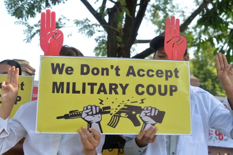 Protesters hold up signs against the military coup in Naypyidaw, Myanmar, on Feb. 18.