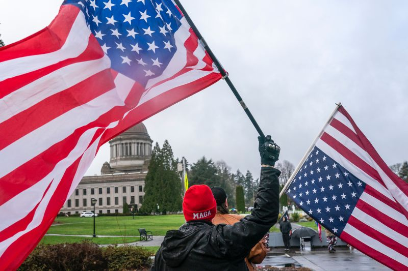 A self-identified member of the Patriot movement flies an upside-down U.S. flag in Olympia, Washington, on Feb. 6.