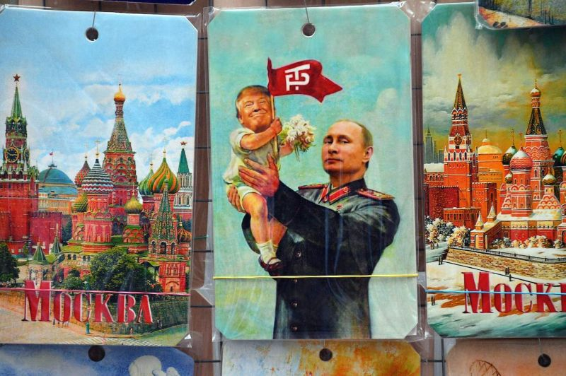 A souvenir kiosk offering among others a drawing depicting Russian President Vladimir Putin holding a baby with the face of U.S. President Donald Trump, in Moscow on July 5, 2017.
