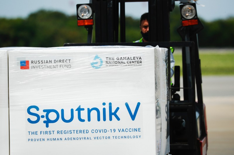 An airport worker uses a forklift to carry a container with doses of Sputnik V vaccine from Russia at Ministro Pistarini International airport in Ezeiza, Argentina on Jan. 16.