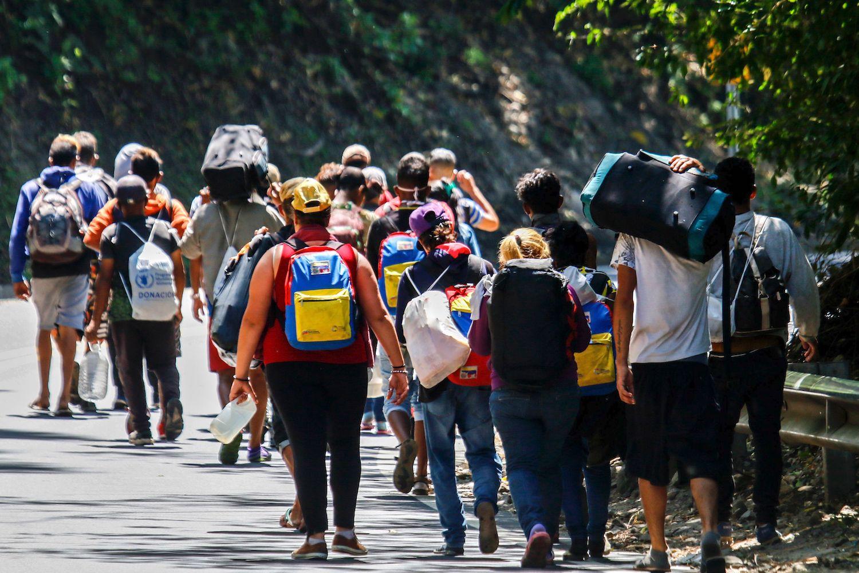 Venezuelan migrants walk along a highway in Cucuta, Colombia, on the border with Venezuela, on Feb. 2.