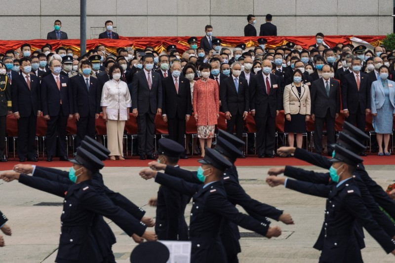 Hong Kong Chief Executive Carrie Lam and other officials attend a flag raising ceremony to mark China's National Day in Hong Kong, on Oct. 1, 2020.
