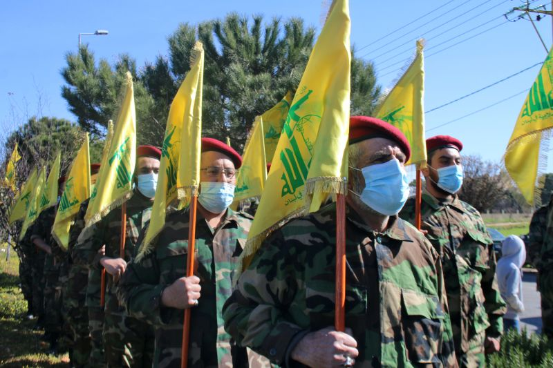 Members of the Shiite movement Hezbollah hold a military parade in the town of Riyaq in Lebanon's Bekaa Valley on Feb. 13, marking the annual anniversary of the group's so-called martyred leaders.