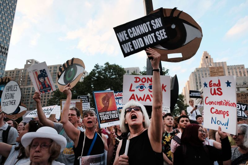 "Hundreds of people gather for a ""Lights for Liberty"" protest against migrant detention camps and impending raids by Immigration and Customs Enforcement (ICE) in New York City, on July 12, 2019."