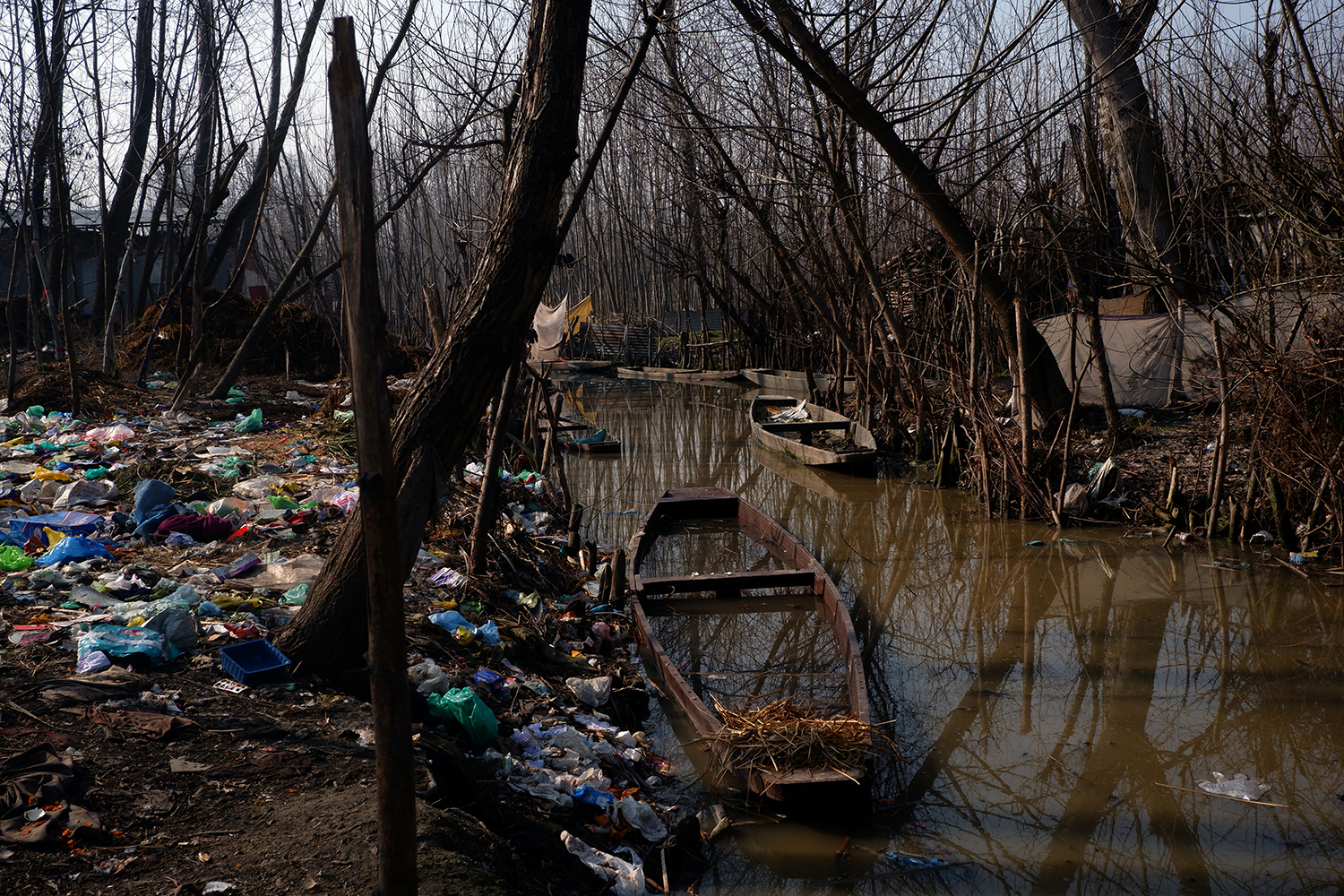 The bank of Anchar Lake is surrounded with garbage and polyethylene bags in Srinagar, Jammu and Kashmir, on Feb. 16.